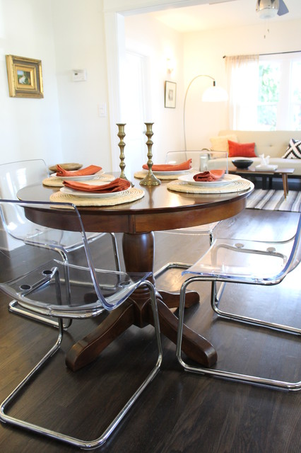 Clear Acrylic Dining Chairs Paired With Traditional Pedestal Table - Traditional dining table with contemporary chairs