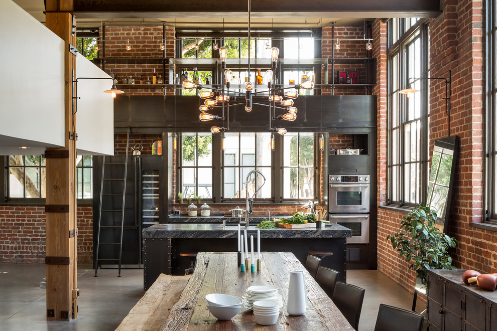 Mid-sized urban concrete floor kitchen/dining room combo photo in San Francisco with multicolored walls and no fireplace