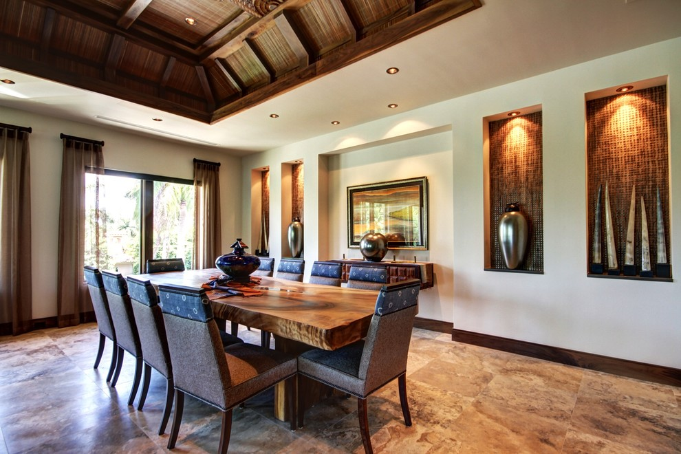 Inspiration for a huge tropical dining room remodel in Miami with beige walls