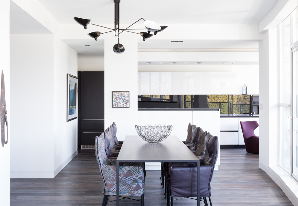 Kitchen/dining room combo - large contemporary medium tone wood floor and brown floor kitchen/dining room combo idea in Vancouver with white walls and no fireplace