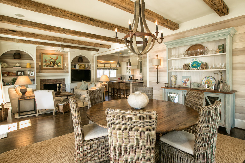Example of a beach style dark wood floor dining room design in Raleigh