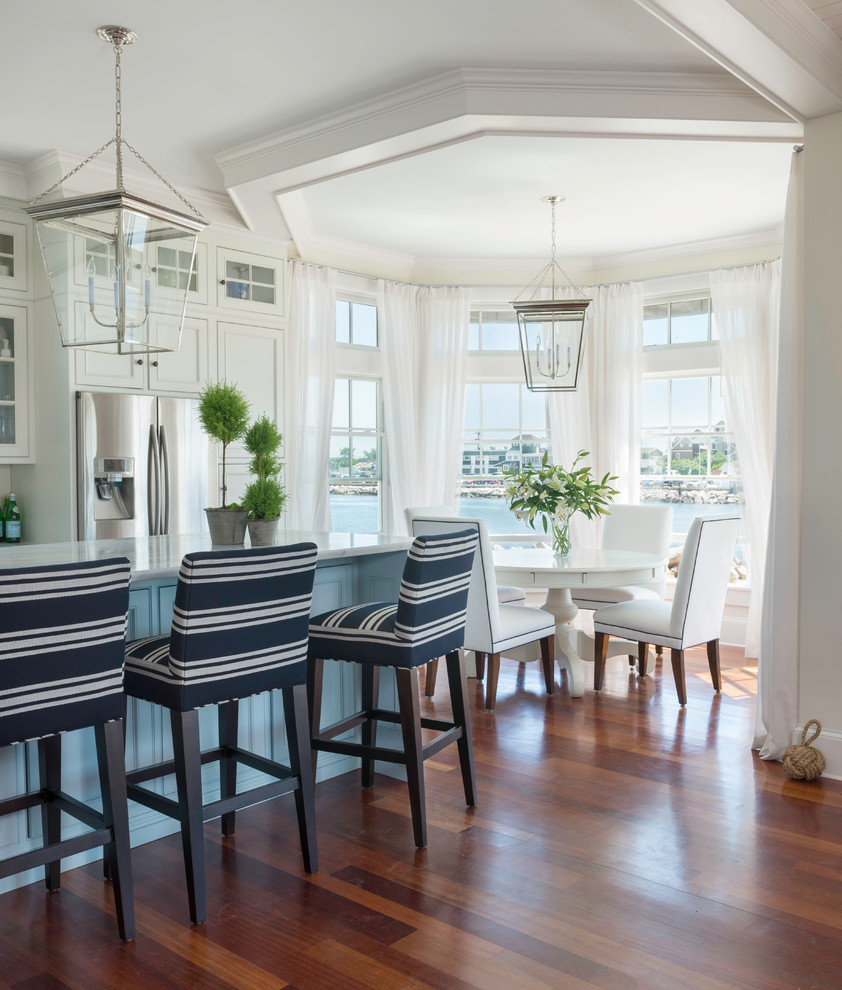 Inspiration for a mid-sized coastal medium tone wood floor kitchen/dining room combo remodel in Providence with white walls