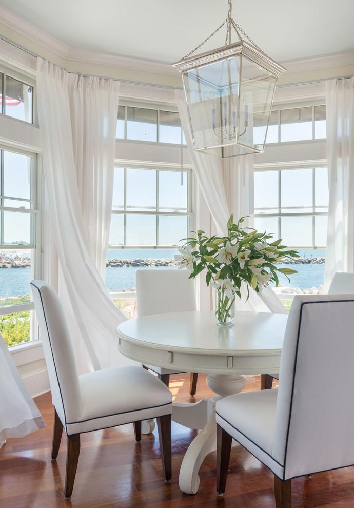 Dining room - mid-sized coastal medium tone wood floor dining room idea in Providence with white walls