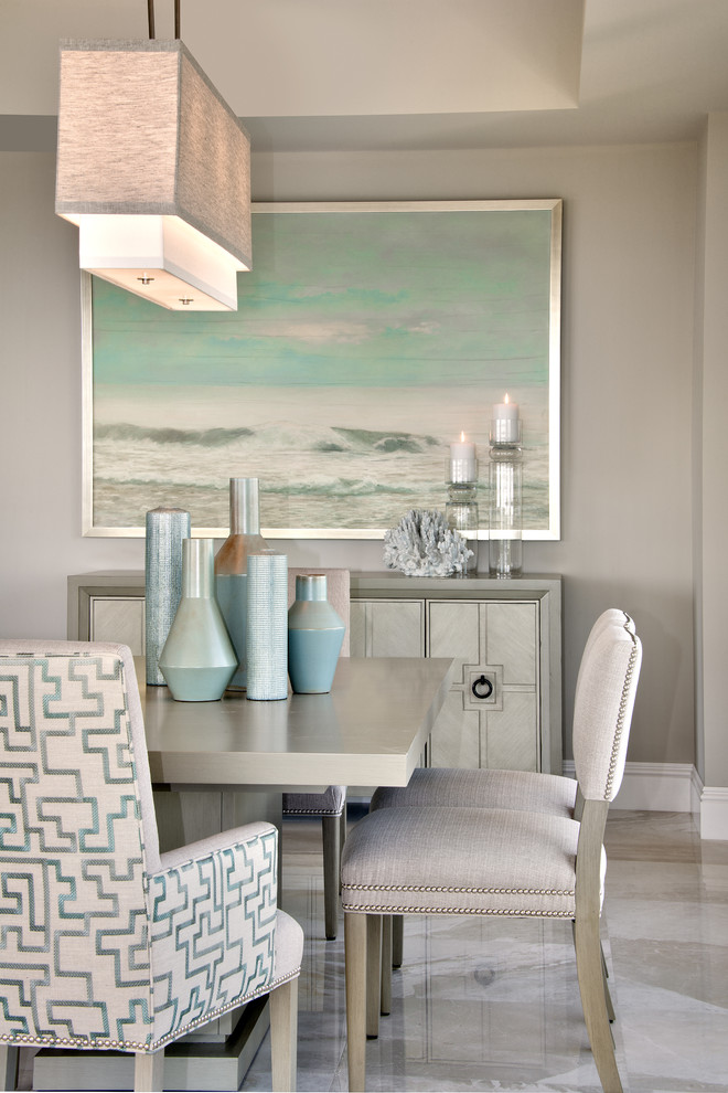 Example of a transitional ceramic tile dining room design in Miami with gray walls