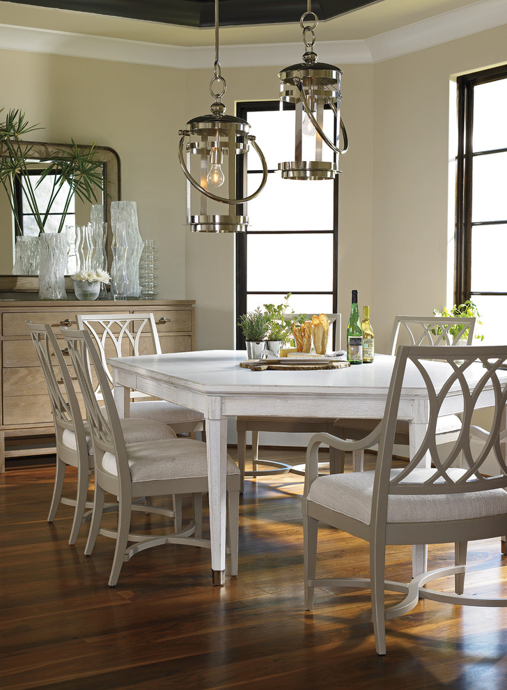Dining room - traditional dark wood floor dining room idea in Miami with beige walls