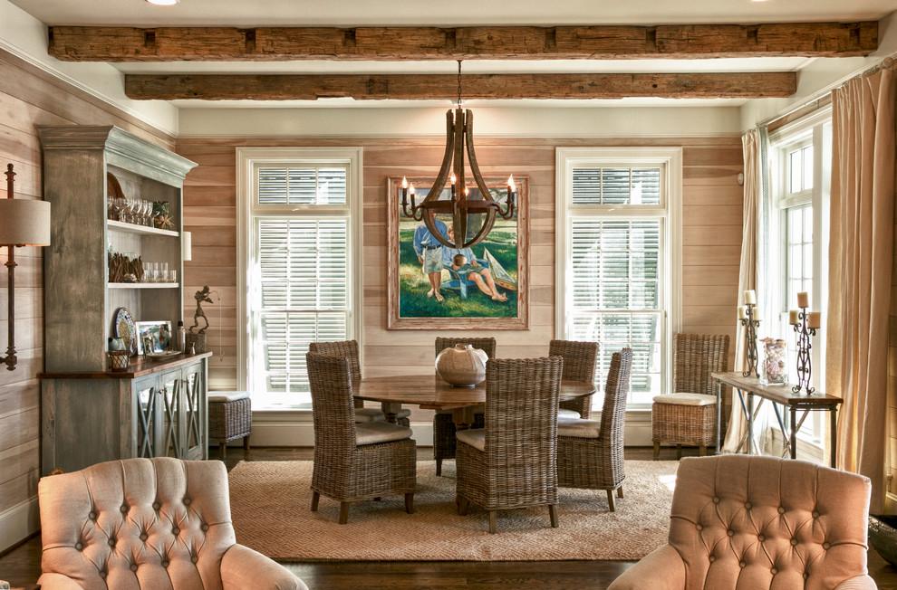 Example of a beach style dark wood floor dining room design in Raleigh