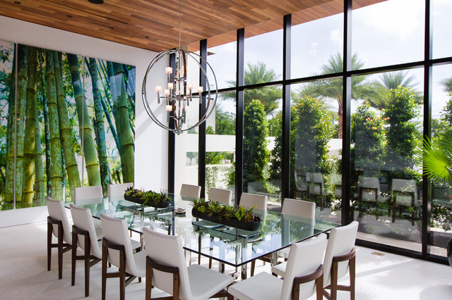 Inspiration for a large contemporary beige floor dining room remodel in Miami with white walls