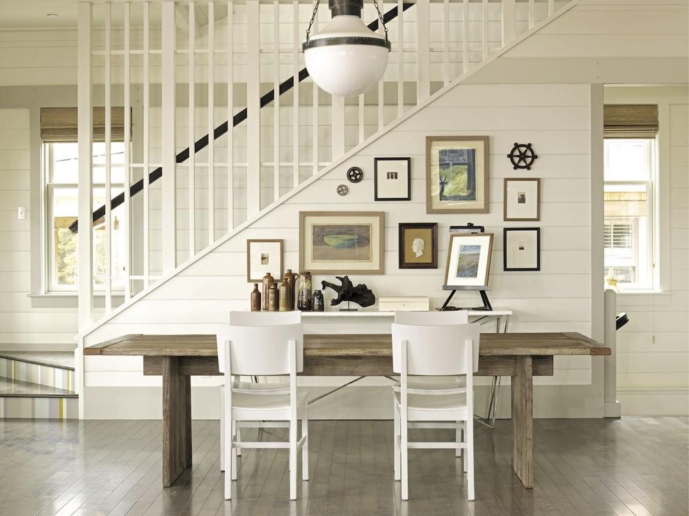 Dining room - coastal dark wood floor dining room idea in New York with white walls