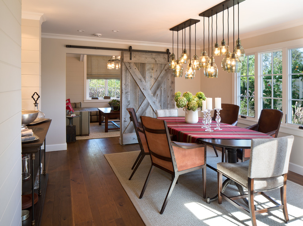 Example of a cottage medium tone wood floor dining room design in San Diego with beige walls