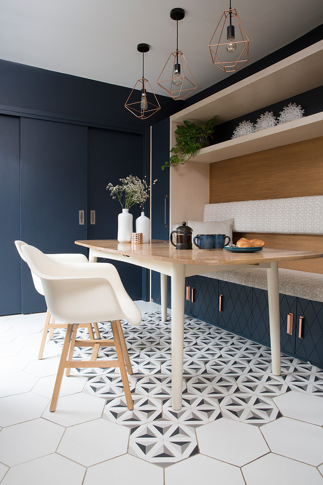 Photo of a small eclectic dining room in Other with multi-coloured floor, blue walls, ceramic floors and no fireplace.