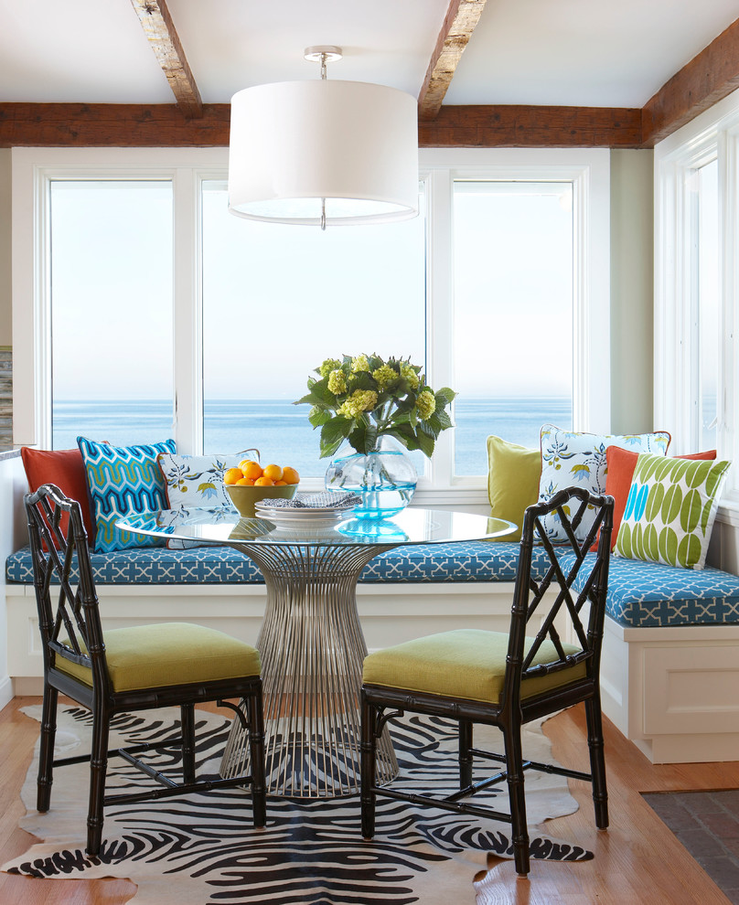 Example of a mid-sized beach style medium tone wood floor kitchen/dining room combo design in Boston with beige walls and no fireplace