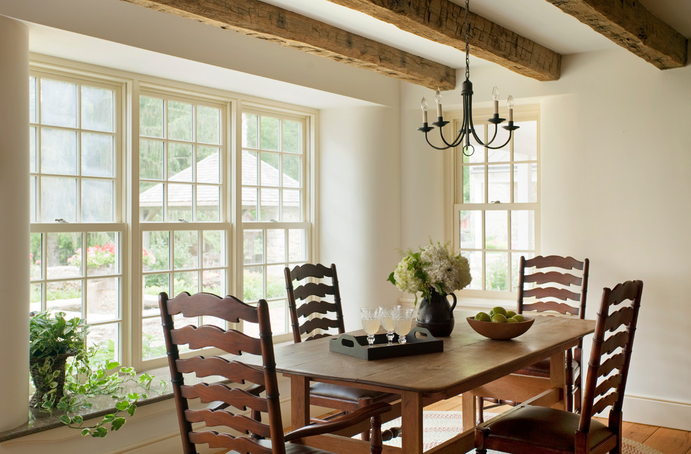 Example of a country kitchen/dining room combo design in Philadelphia with white walls