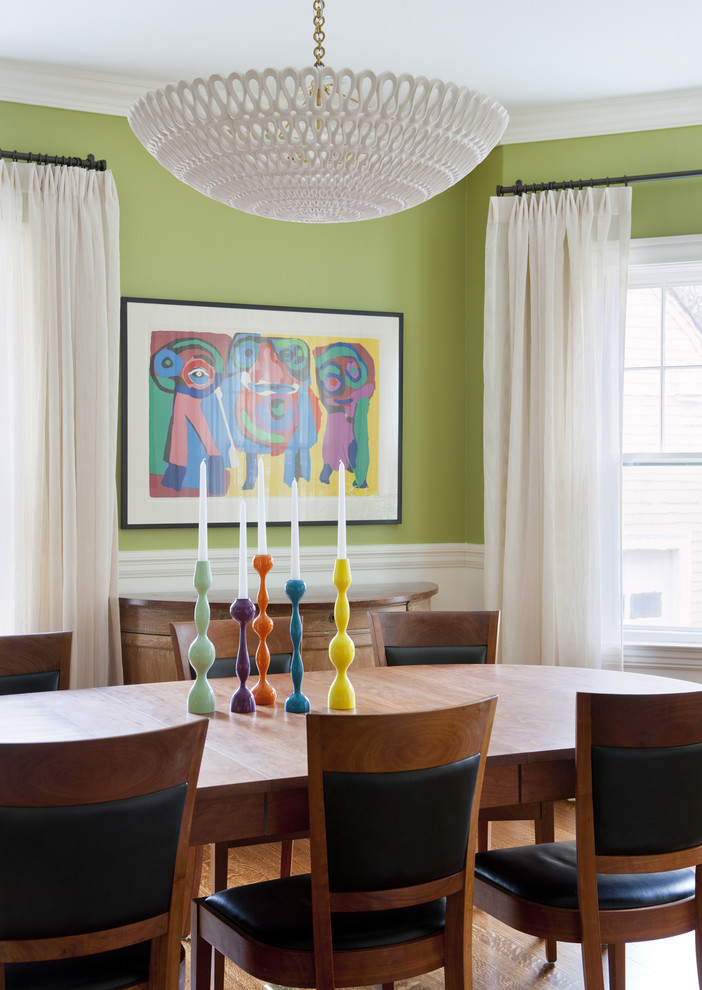Eclectic medium tone wood floor dining room photo in Boston with green walls