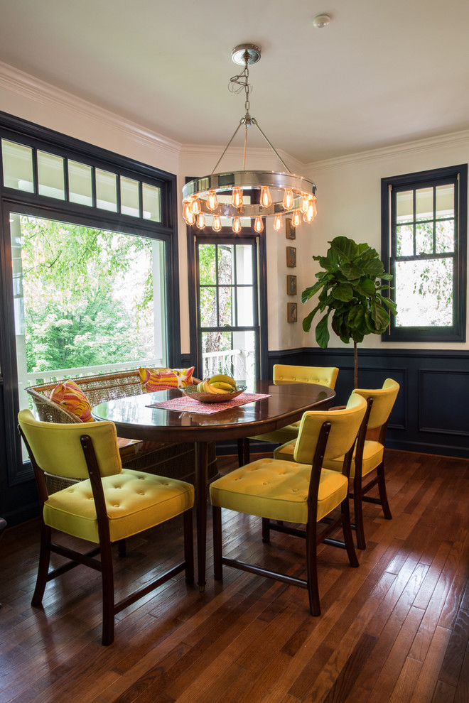 Example of a transitional dining room design in Other with white walls
