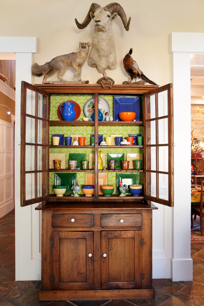 Inspiration for an eclectic dining room remodel in Los Angeles with beige walls