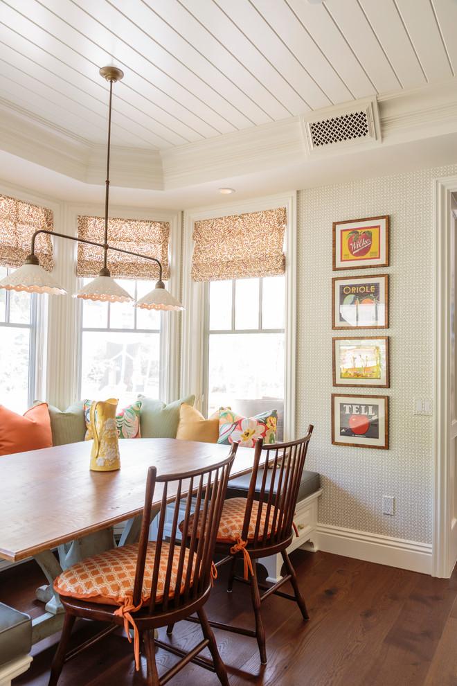 Elegant medium tone wood floor kitchen/dining room combo photo in Los Angeles with beige walls