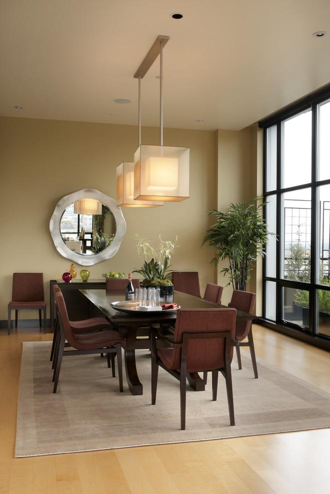 Dining room - modern light wood floor dining room idea in Portland with beige walls