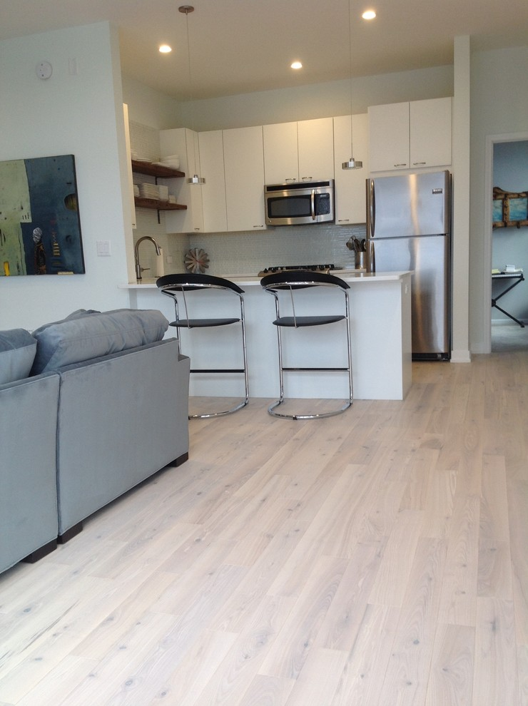 Inspiration for a small contemporary light wood floor kitchen/dining room combo remodel in Chicago with white walls and no fireplace