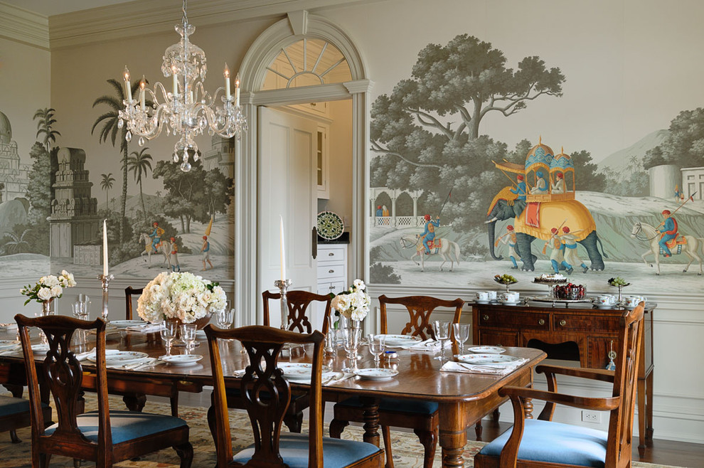 Ornate enclosed dining room photo in New York with multicolored walls