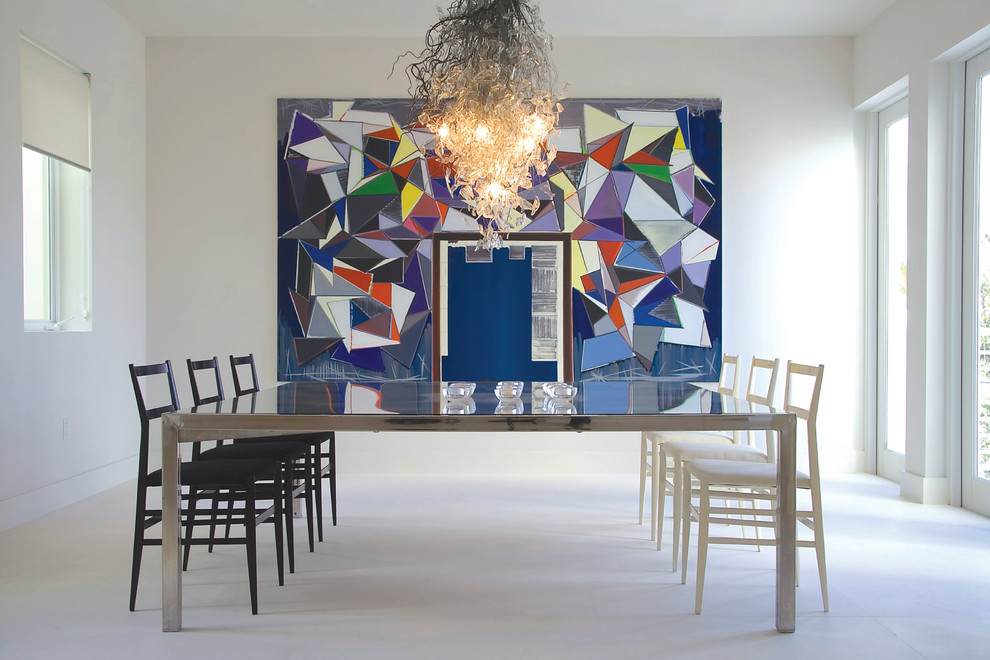 Trendy white floor dining room photo in Miami with white walls