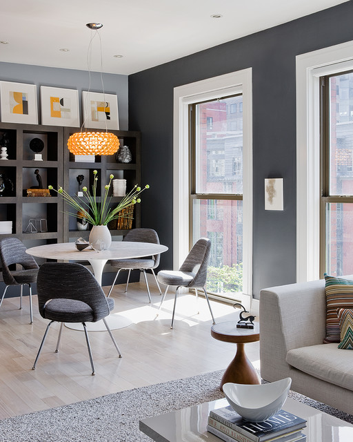 Example of a mid-sized trendy light wood floor and beige floor great room design in Boston with gray walls and no fireplace