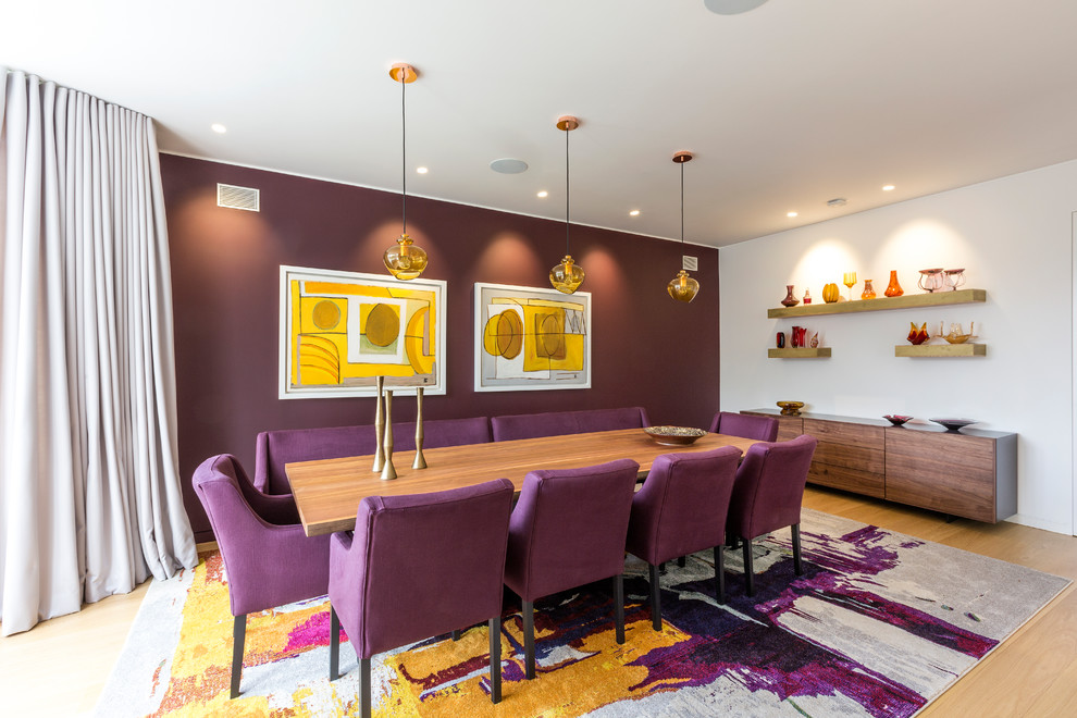 Trendy light wood floor and beige floor dining room photo in London with purple walls