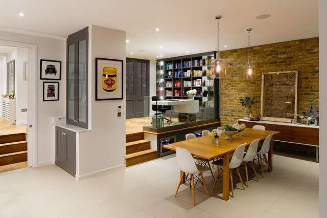 Dining room - contemporary dining room idea in London with white walls