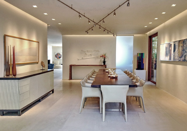 Inspiration for a large contemporary porcelain floor dining room remodel in Los Angeles with white walls and no fireplace
