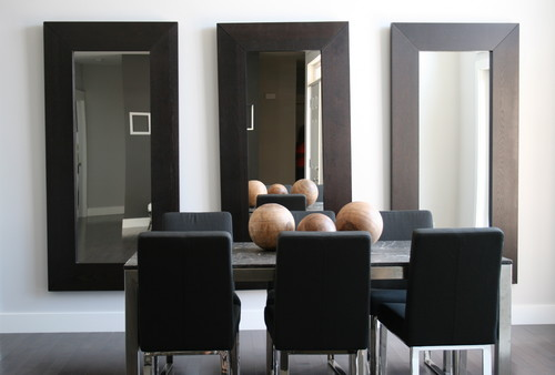 Hang A Large Mirror Above The Bathtub Or Any Blank Wall Reflective Property Of Will Create Illusion E In Tiny Bathroom