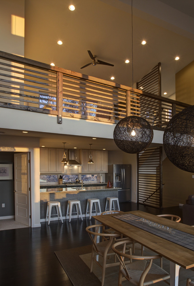 Inspiration for a contemporary kitchen/dining room combo remodel in New York with brown walls