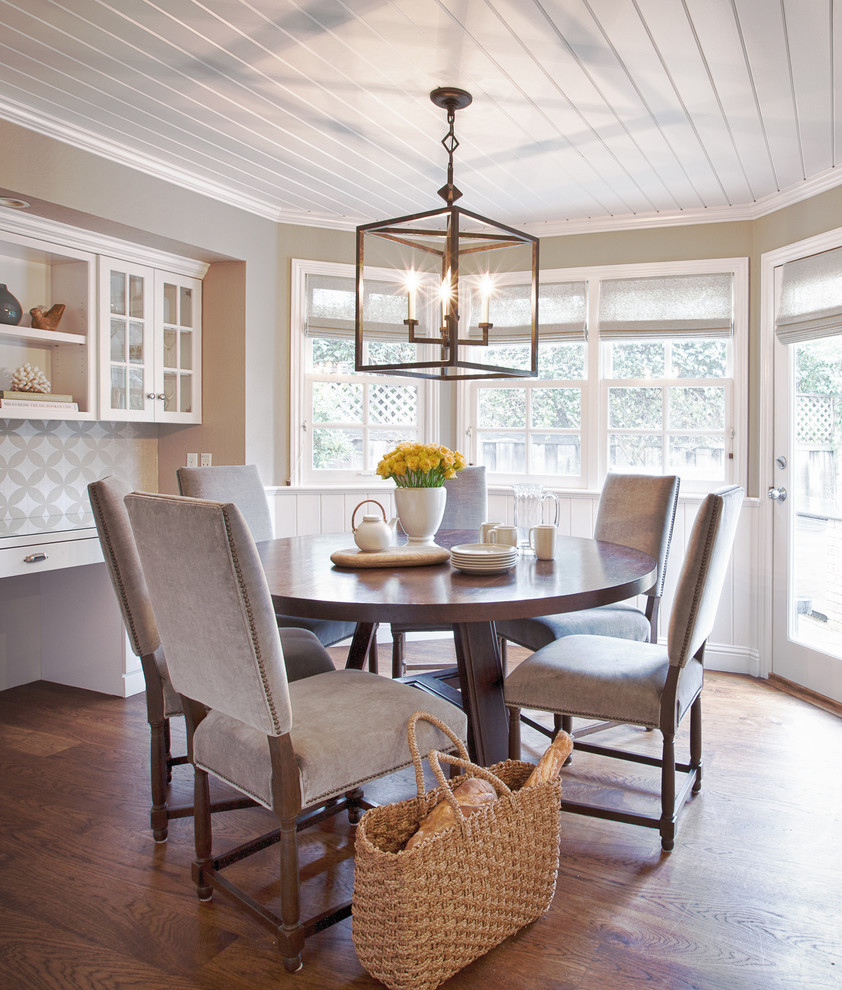 Example of a large transitional dark wood floor and brown floor enclosed dining room design in San Francisco with gray walls and no fireplace