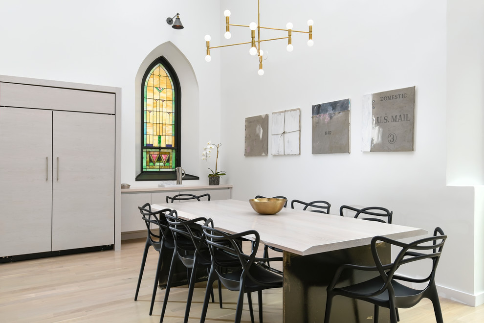 Trendy light wood floor dining room photo in Chicago with white walls