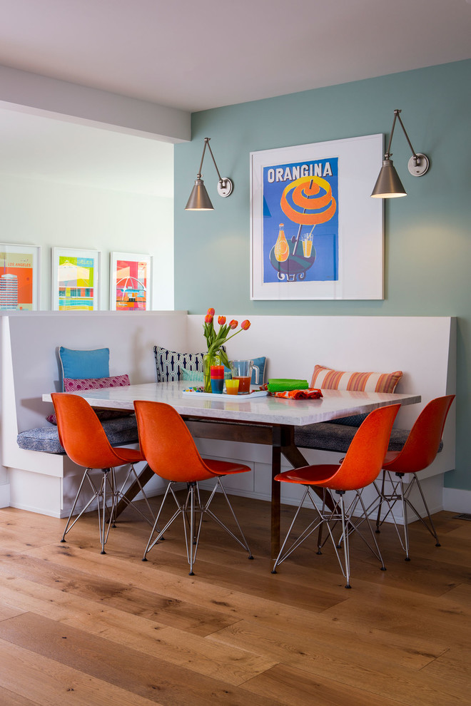 Example of a trendy medium tone wood floor dining room design in New York with blue walls