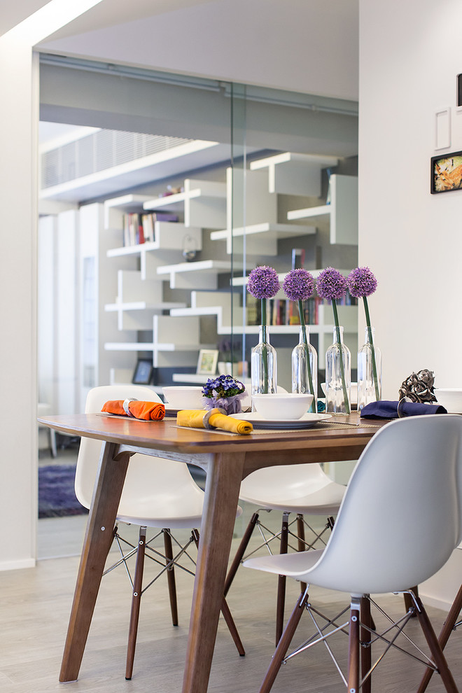 Example of a trendy dining room design in Hong Kong with white walls