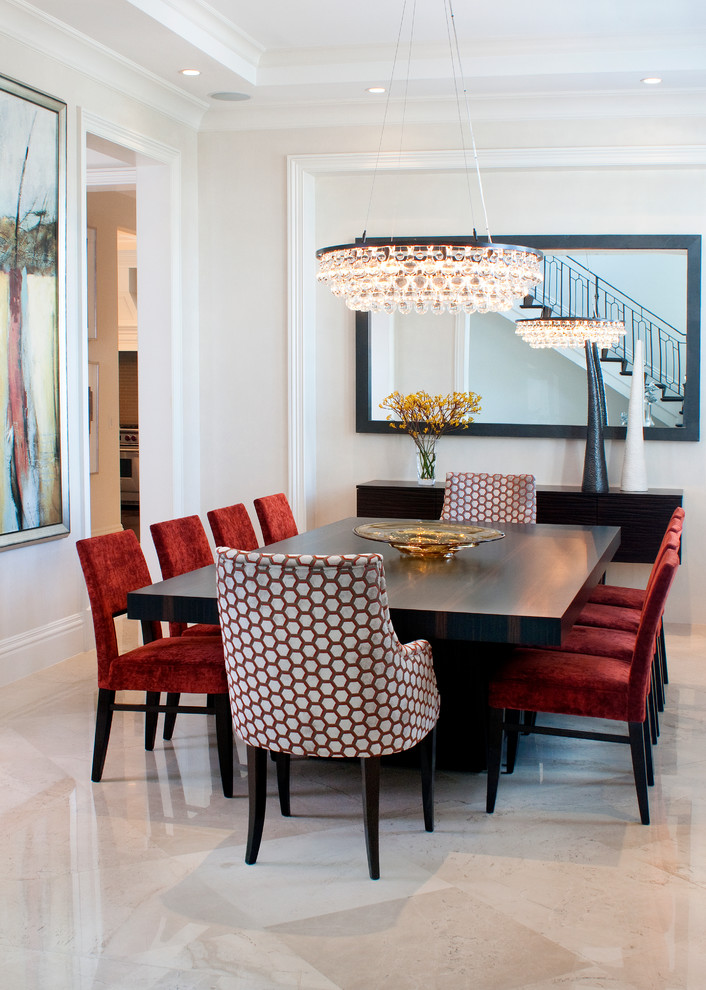 Example of a trendy marble floor dining room design in Miami with white walls