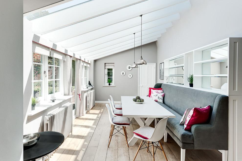 Dining room - contemporary medium tone wood floor dining room idea in London with gray walls