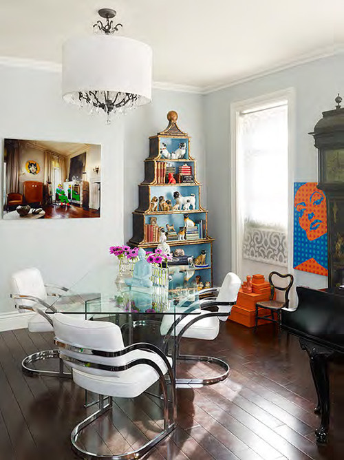 Contemporary dining room with a stack of hermes boxes and pop art!