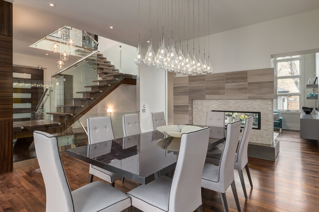 Contemporary dining room with two way fireplace and custom for 2 way fireplace