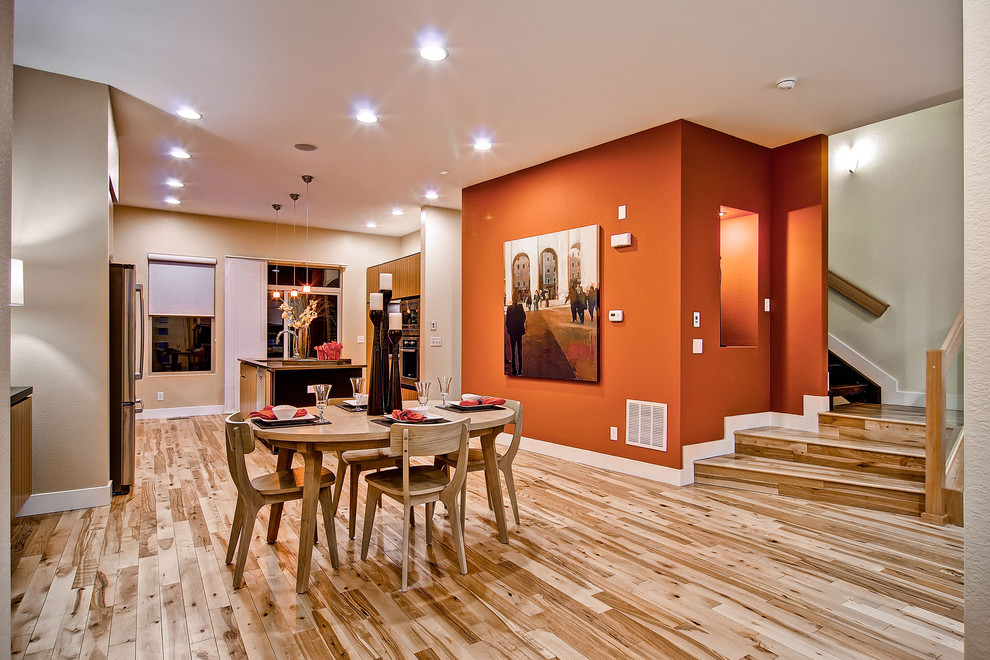 Inspiration for a contemporary medium tone wood floor kitchen/dining room combo remodel in Denver with orange walls