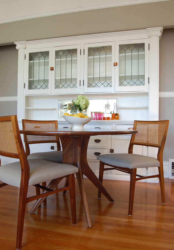 Example of a transitional medium tone wood floor dining room design in San Francisco with beige walls