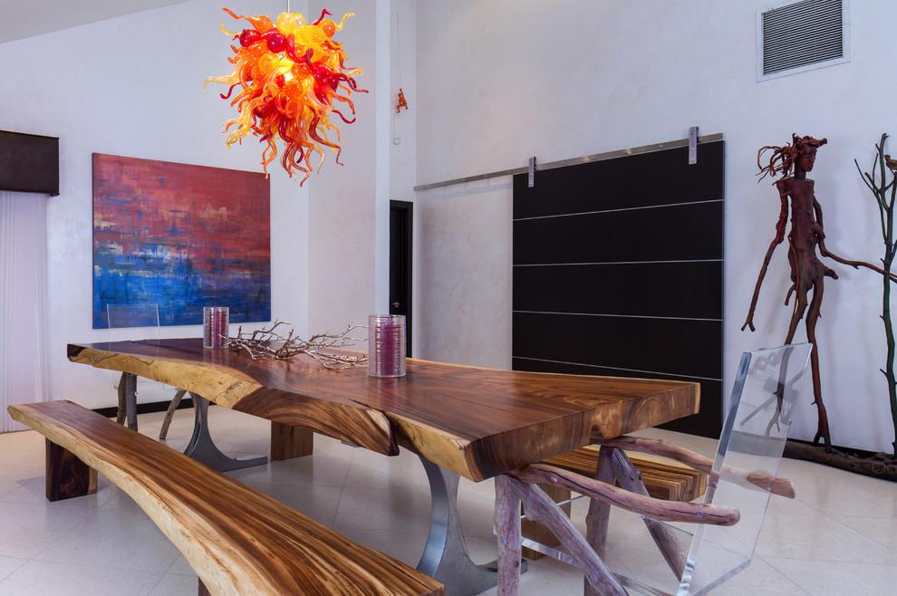 Example of a trendy ceramic tile dining room design in Orlando