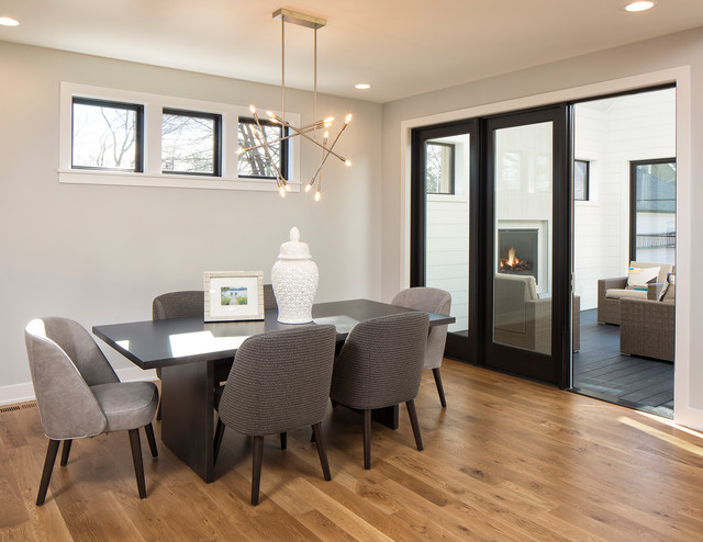 Kitchen/dining room combo - mid-sized contemporary light wood floor and brown floor kitchen/dining room combo idea in Minneapolis with gray walls