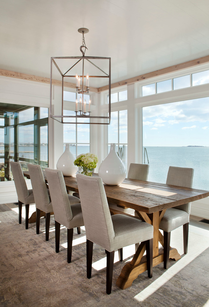 Example of a beach style beige floor dining room design in New York