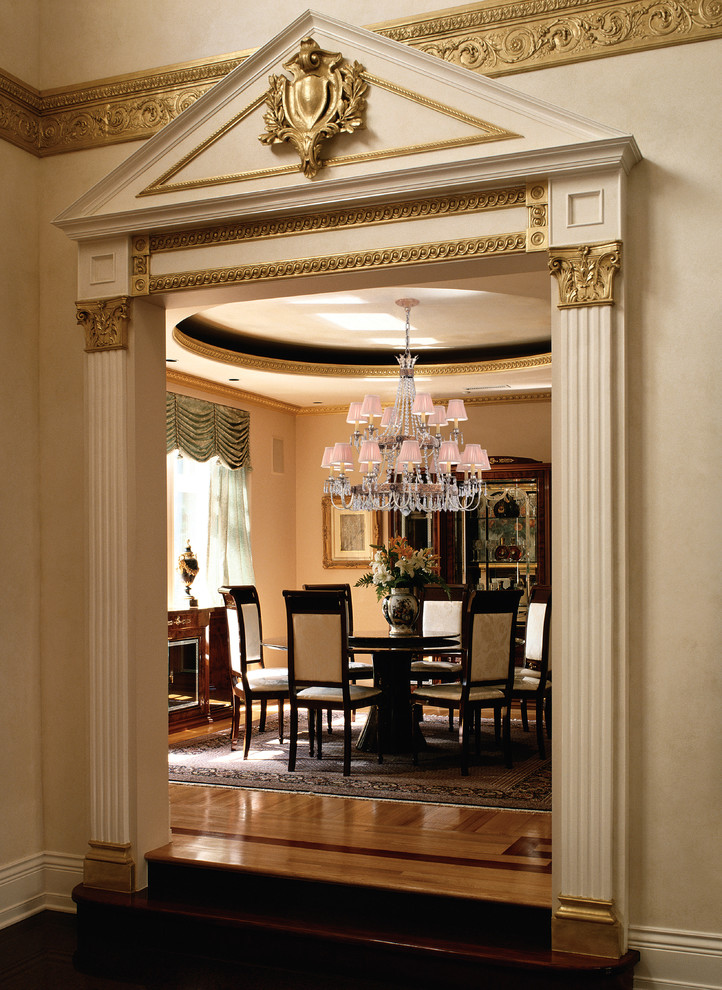 Dining room - traditional medium tone wood floor dining room idea in Miami with beige walls