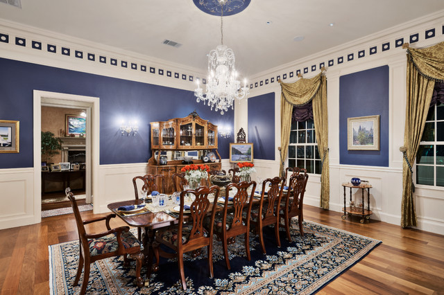 Example of a classic medium tone wood floor dining room design in Austin with blue walls