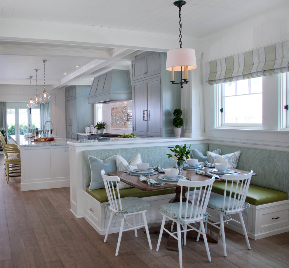 Inspiration for a coastal medium tone wood floor kitchen/dining room combo remodel in San Diego with white walls