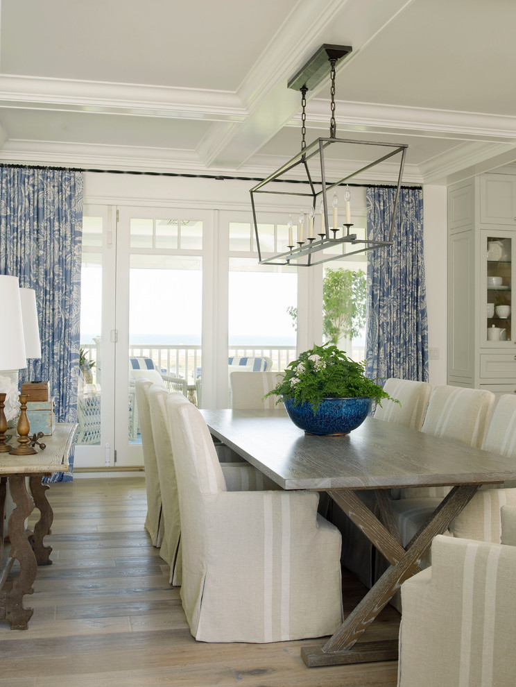 Great room - large beach style light wood floor great room idea in San Diego with white walls