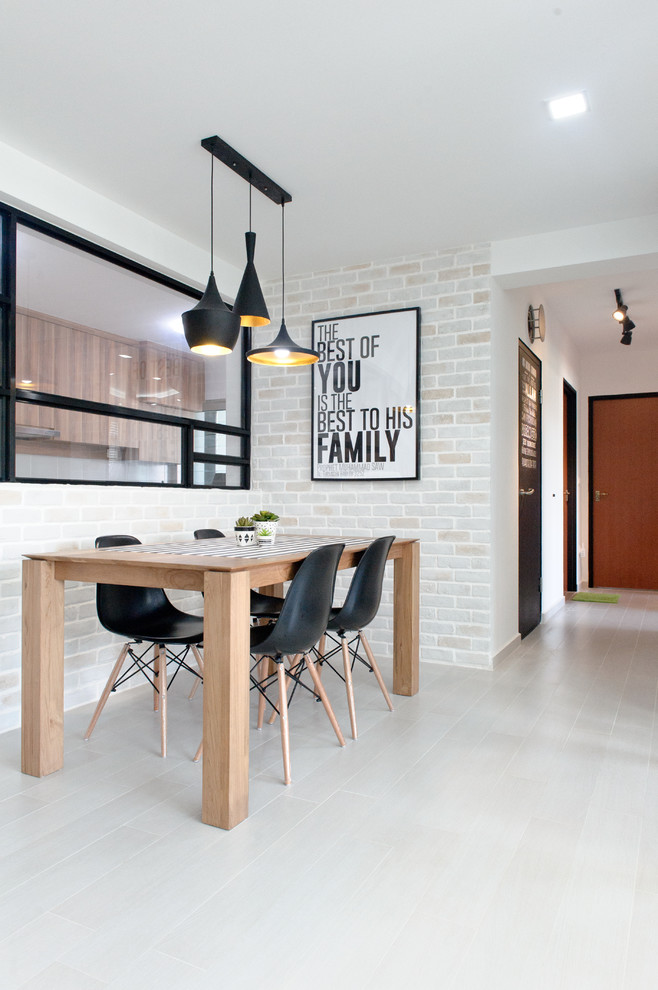 Inspiration for a scandinavian porcelain tile dining room remodel in Singapore with beige walls