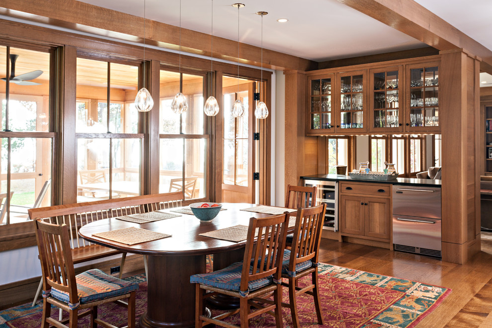 Example of an arts and crafts dark wood floor kitchen/dining room combo design in Boston with white walls