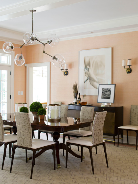 Inspiration for a contemporary dining room remodel in Dallas with orange walls